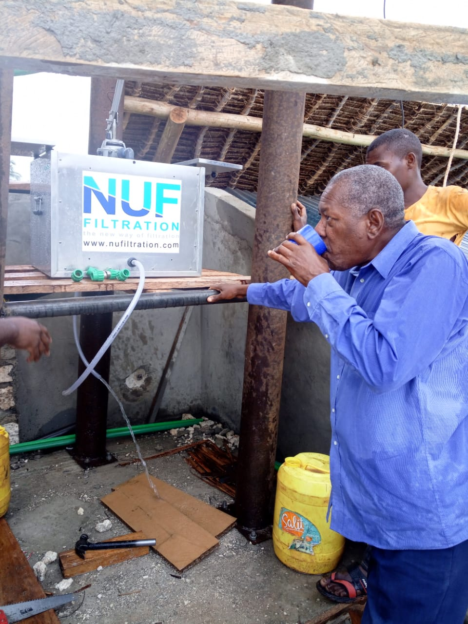 Man drinking clean water from Nufiltration